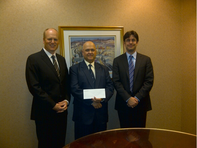 Richard Warman presents a donation of $1,000 to Wayne Nightingale (centre), head of the Military Family Resource Centre.  The money came about from a libel lawsuit where Mr. Warman accepted damages and agreed with the defendant to donate them to helping military families in need.  James Katz, Mr. Warman's lawyer at law firm Brazeau Seller is pictured right.